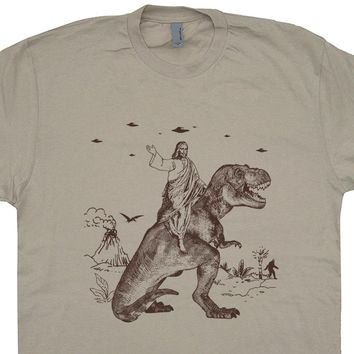 Jesus Riding Dinosaur Shirt Jesus On a Dinosaur T Shirt UFO T Shirt Cryptozoology Tee Shirt