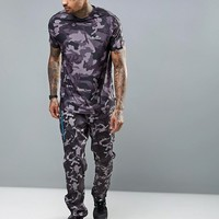 Ellesse T-Shirt With Small Logo In All Over Camo Print at asos.com