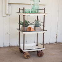 Three Tiered Recycled Enameled Trays On Wooden Casters