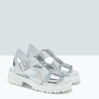 Shiny cage sandals