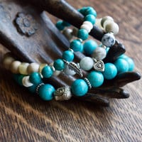 Turquoise bracelet set of three | Buddha bracelet stack set | Bohemian chic | Silver feather charm | Turquoise mala bead | Freedom intention