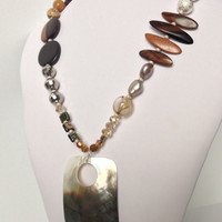 Large Shell Pendant and Asymmetric Toffee Shade Necklace with Wood