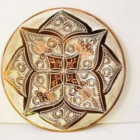 Copper decorative plate. Engraving and drawing by hand.