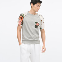 T-SHIRT WITH FLORAL PRINTED SHOULDERS AND POCKET New