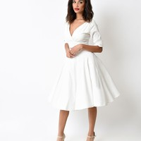 Unique Vintage 1950s Ivory Delores Sleeved Swing Dress