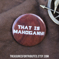 That is Mahogany Hunger Games Pin Pinback by TreasuresForTributes