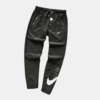 Nike Joggers Loose Fit Tapered Ankles Black