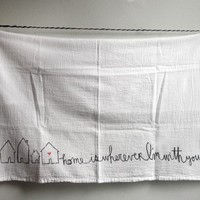 flour sack towel with song lyric home is wherever i'm by besty