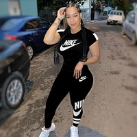 NIKE Women With short sleeves Top trousers Two-Piece