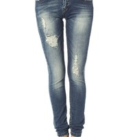 Skinny jeans with all over rips & distressing