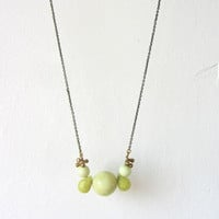 Long antique gold brass beaded necklace, jade and yellow turquoise gemstones.
