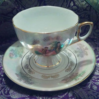 Fine Porcelain Pedestal Opalescent Victorian Courting Couple Design Teacup and Saucer Tea Set, Pink White With Gold Trim