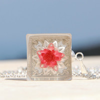 Rectangle OOAK pendant with a tiny real red flower on 3D silver flower filigree, floating over a rectangle silver filigree, encased in resin