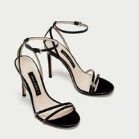 PATENT LEATHER SANDALS WITH STRAPS DETAILS