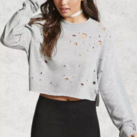 Women Solid Color Personality Hollow Ripped Burning Flowers Backless Long Sleeve Sweater Tops