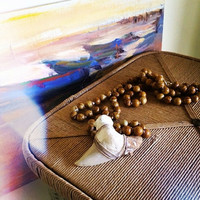 Wooden bead necklace with shark tooth pendant