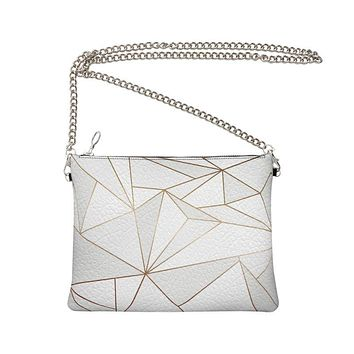 Abstract White Polygon with Gold Line Crossbody Bag With Chain by The Photo Access