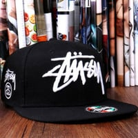 The World Tour Maroon Snapback Hat by Stussy Black white letters