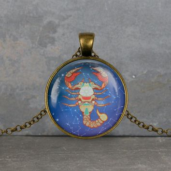 Scorpio zodiac pendant, blue background, your choice of silver or bronze and necklace or key ring
