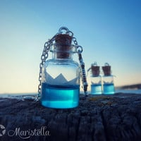 HANDMADE origami PAPER BOAT bottle necklace. Blue sea necklace. Miniature sea in a glass vial necklace. Cute and tiny glass bottle pendant.