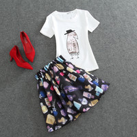 White Graphic T-Shirt with Perfumes Print Pleated Skirt