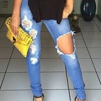 Mid-Waisted Ripped Design Jeans