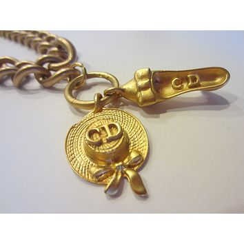 CD Charms On Brass Link Chain Symbolizing Shoe And Hat