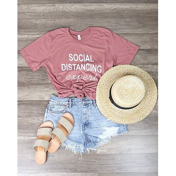 Distracted - Social Distancing Expert Funny Graphic Tee in Pink
