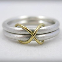 infinity wedding ring or commitment ring in sterling silver and 18 karat gold