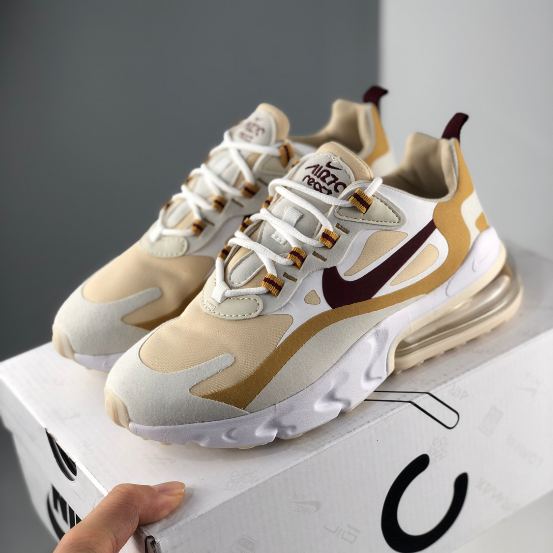 Image of Nike Air Max 270 React soft foam midsole fashion cushioned running shoes