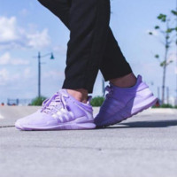Adidas purple sneakers