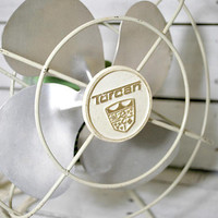 vintage table fan from the 60's , green mid modern desk fan , office and home decor . home sweet home . atomic era