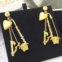 Versace New fashion love heart human head long earring women Golden