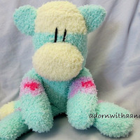"Sockimamy  ""Eliot"" a yellow and mint green fuzzy sock monkey with pink and purple flowers"