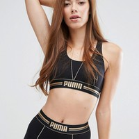 Puma Gold Logo Cross Back Bra at asos.com
