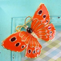 "Butterfly Brooch Orange Enameled with Ruby Red Spots in Goldtone Setting, Clear Rhinestone Eyes & Body, 2.25"" Wingspread, Insect Figural Pin"