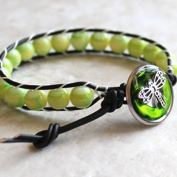 Springtime green glass beads, leather wrap bracelet with dragonfly button closure
