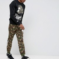 AAPE By A Bathing Ape Joggers With AAPE Badge Print in Camo at asos.com
