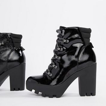 Calvin Klein Sharla black heeled lace up ankle boots at asos.com