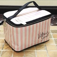 Victoria's Secret, the big trumpeter with a square makeup box