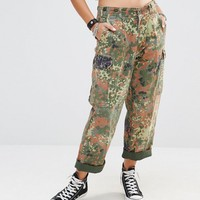 Milk It Vintage High Waist Relaxed Fit Military Pants In Camo at asos.com