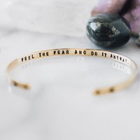 Feel the fear and do it anyway. Brass gold cuff with arrows.