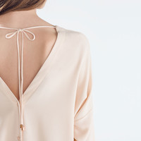 Nude Pink Long sleeve blouse with back buttons   ZARA