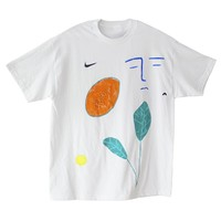 Plant, papaya, face, nike swoosh, sun, and tiny ancient pottery by bfgfshop