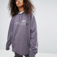 Ellesse Oversized Boyfriend Hoodie With Tonal Logo And Ribbon Tie Back at asos.com