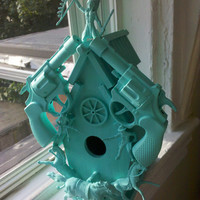 teal cowboy gun birdhouse sculpture by CheeseCrafty on Etsy