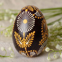 Handmade Lemkiv decorative Easter egg with bright flowers on black background