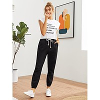 SHEIN Drawstring Waist Slant Pocket Carrot Pants