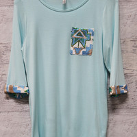 Walking On Air Baby Blue Tunic Top With Sequin Pocket And Quarter Length Sleeves