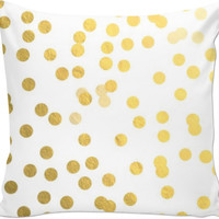 Gold and white throw pillow